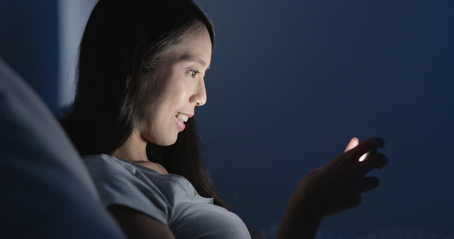 Woman playing game on smart phone