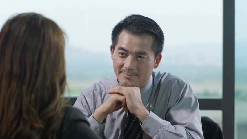 asian business man and woman talking in office.