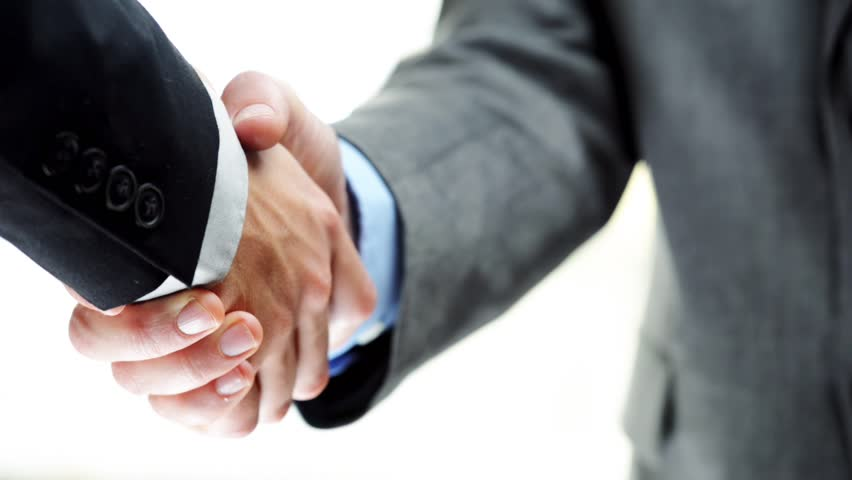 Businessmen shaking hands business deal partnership high definition