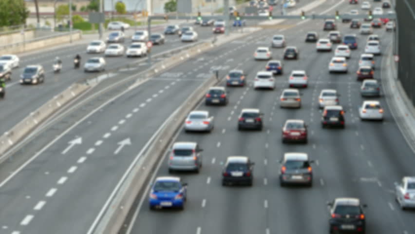 Blurred evening urban traffic scene with a top and rear view access roads to Barcelona. | Shutterstock HD Video #28775311