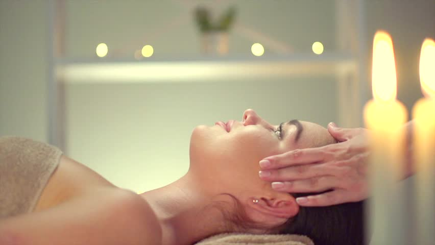 Spa facial Massage. Face Massage in beauty spa salon. Beauty Treatments. Body care, skin care, wellness, wellbeing, beauty treatment concept. Slow motion 240 fps 4K UHD video 3840x2160