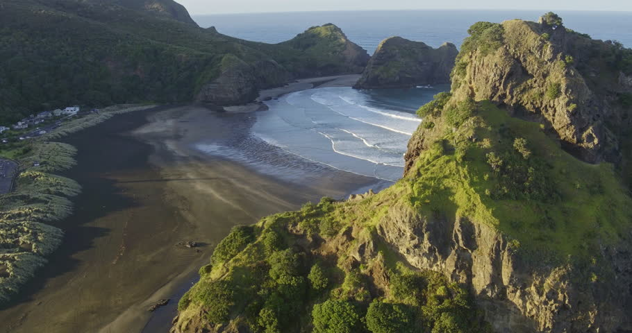 Aerial over beach at piha towards lion rock, Auckland, New Zealand