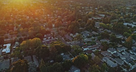 Aerial View Over Silicon Valley Mountain View And Suburban Houses at sunset