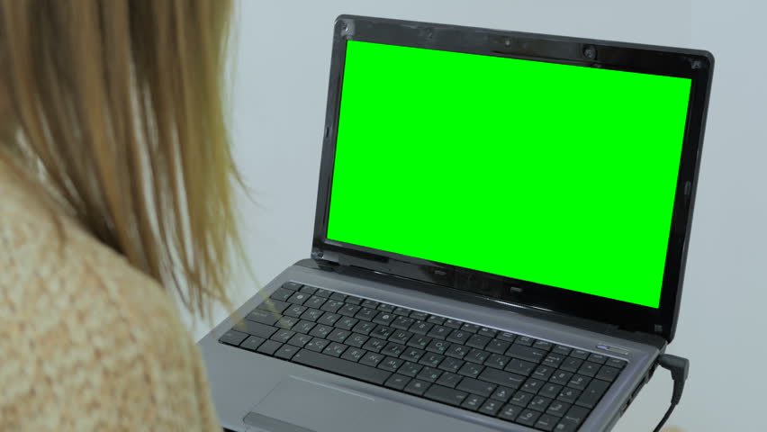 Woman using laptop with green screen. Woman's hands typing on a laptop keyboard. Business, communication, freelance and internet concept | Shutterstock HD Video #28809121