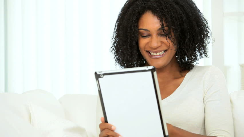 Pretty ethnic woman using online video web chat technology on wireless tablet | Shutterstock HD Video #2882530