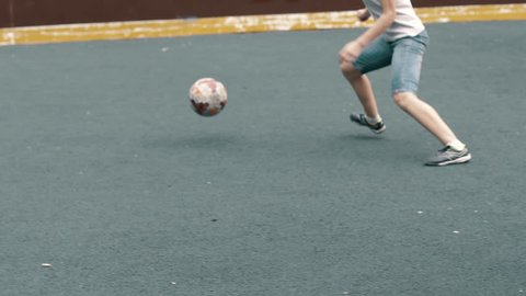 Woman soccer player beats ball with her foot slow motion. Woman football team. Female footballer. Female football player. The ball flies into the camera, the soccer ball got into the videographer.