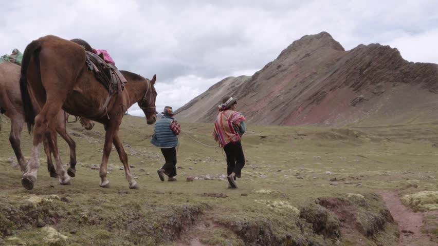 Peruvian men wearing a highlander hats walking with horses on the mountains of Peru. Slow motion | Shutterstock HD Video #28862221