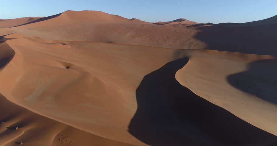 Aerial panning view of  one of the vast sand dunes in the Namib desert | Shutterstock HD Video #28866151