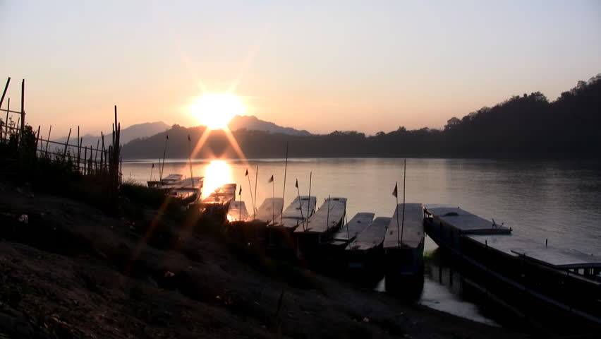 Timelapse of sun setting down on the Mekong river in Luang Prabang Laos