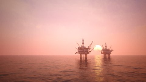02839 Two offshore platforms or oil rigs at sunset pink sky