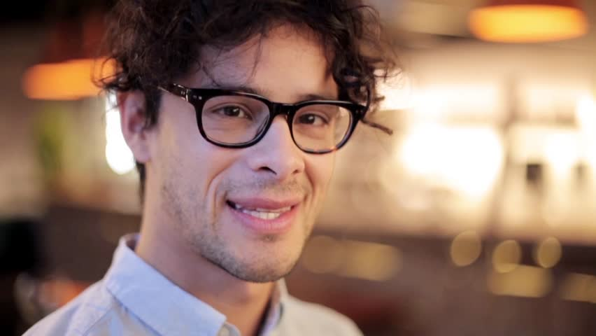 People, emotion and facial expression concept - face of happy smiling man in glasses   Shutterstock HD Video #28965031
