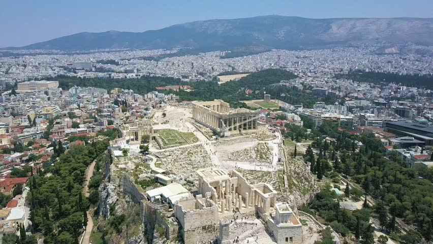 Slow Panning Aerial Video of the Parthenon and the Ruins in Athens Greece. Includes shots of the Acropolis the surrounding ruins.