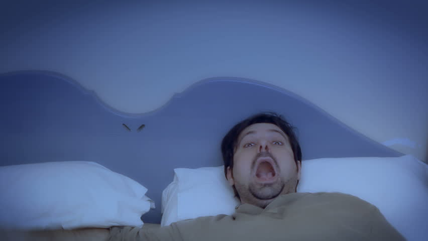 A sleeping man's reaction to something scary or annoying. See my other "
