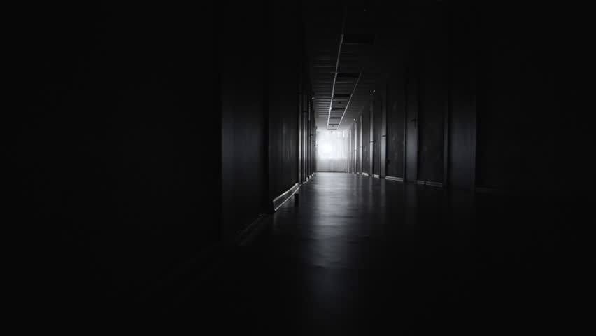 PAN with wide shot of dark and empty hospital hallway