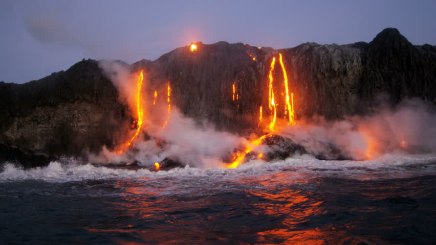 Erupting volcanic red hot lava pouring into the Pacific ocean from Kilauea seen before dawn Hawaii USA RED EPIC