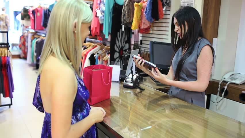 Credit card transaction completed at till in clothing store