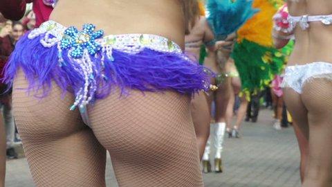 Concept Brazilian carnival. Street Samba dancers in full costume before start of carnival procession