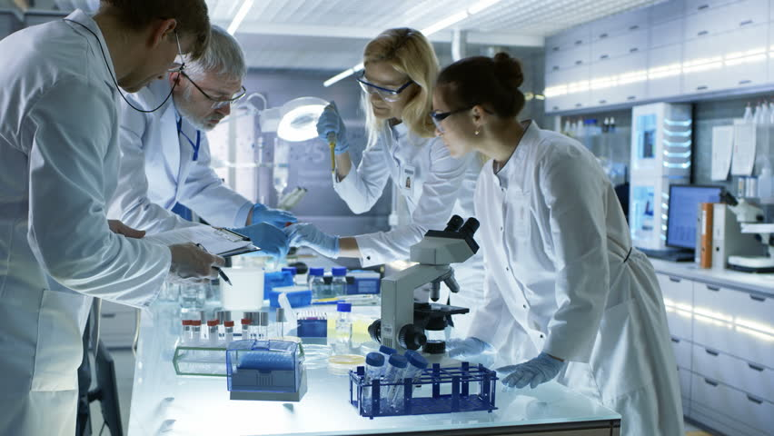 Team of Medical Research Scientists Work on a New Generation Disease Cure. They use Microscope, Test Tubes, Data Implementing Technology. Laboratory Looks Busy, Bright and Modern. 4K UHD. | Shutterstock HD Video #29109001
