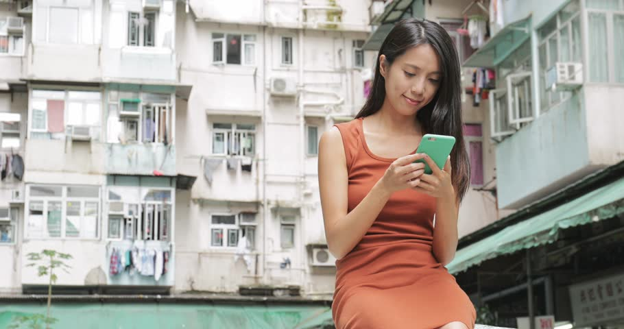 Woman using cellphone in the city | Shutterstock HD Video #29135911