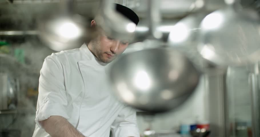 young Asian chef working in a restaurant kitchen
