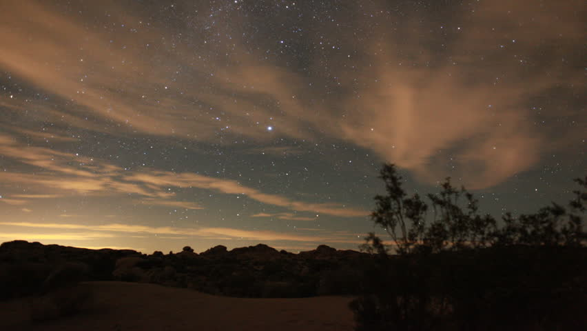 Incredible Night Sky Stars Passing Over Joshua Tree in long exposure timelapse.