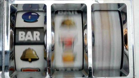 Slot machine spinning to triple bar.