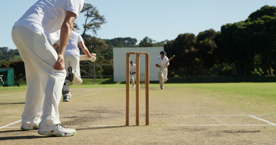 Bowler running out a player during match on cricket field
