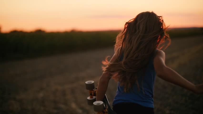 Girl Kid Playing Outdoors Sunset Skateboard  Slow motion | Shutterstock HD Video #29211391
