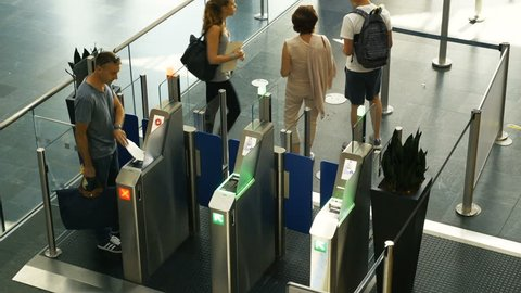 Basel, Switzerland - Circa 2017: Group of friends tourists commuters people men and women using ePassport gates airport border control EuroAirport Basel Mulhouse Freiburg for ticket passport id scan