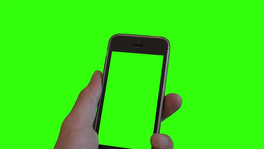 Hand Holds Smartphone Over Green Screen. Hand holding a green screen smartphone over a green screen background #29223001