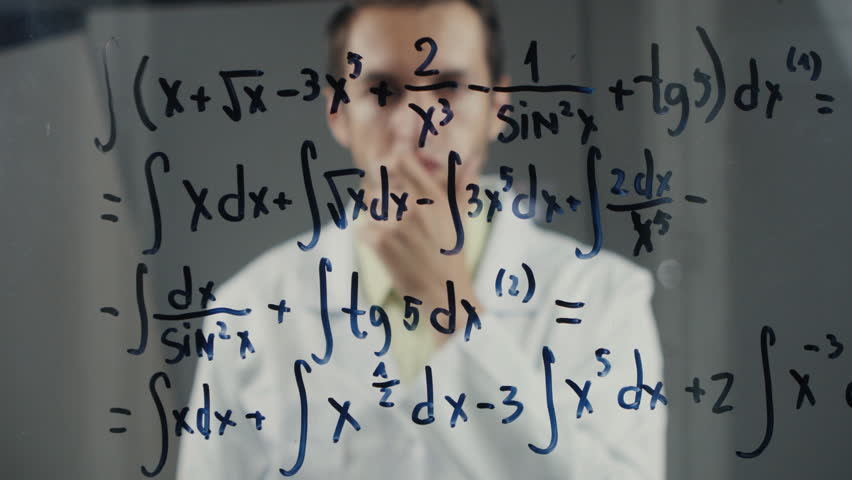 Man Scientist thinks over the solution of the integral equation. The mathematician solves the problem.