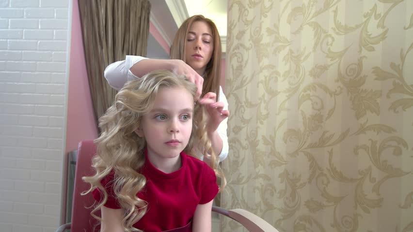 Little blonde girl, hair salon. Female hairdresser and a kid. | Shutterstock HD Video #29290441