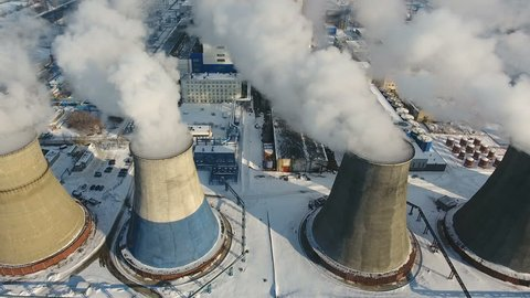 Smoke from chimneys at a thermal power station. Drone shot.