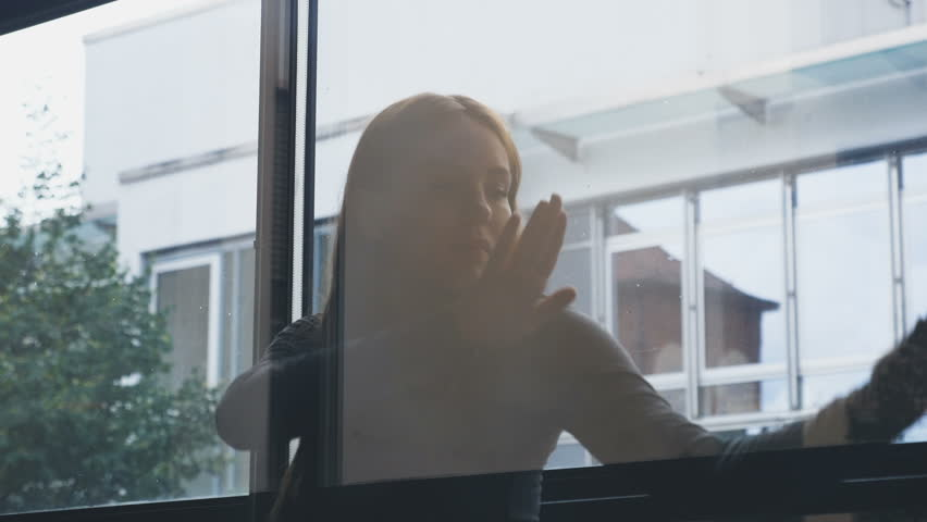 A girl dances behind a glass partition and a window.   | Shutterstock HD Video #29324491