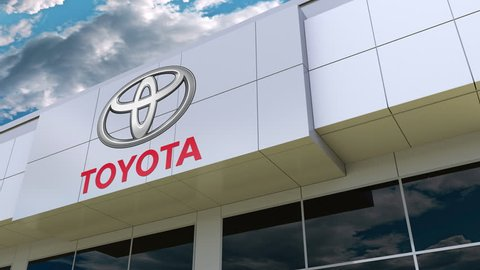 Toyota logo on the modern building facade. Editorial 3D rendering