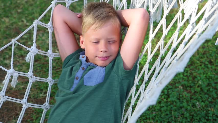 Image of: Jpg Point Of View Shoot Of Cute Funny Smiling Kid Laying And Relaxing In Hammock Hanging On Trees In Summer Pine Wood Real Time Full Hd Video Footage Meme Point Of View Shoot Of Stock Footage Video 100 Royaltyfree