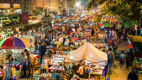 Baguio, Philippines - May 1, 2017: Baguio Timelapse view showing night market crowds of people shopping at night