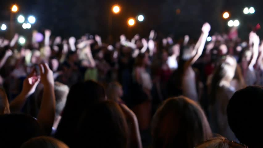 Celebration in holiday, feast rejoicing. Night music concert, musical performance, Lights, glare from searchlights. Disco show colorful illumination. Applause, dancing crowd of youth, fans  hands up.  | Shutterstock HD Video #29365141