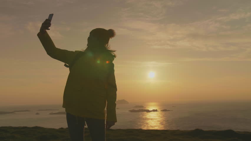 Happy Traveler Taking Selfie With Smartphone On Mountain Above Sea | Shutterstock HD Video #29373991