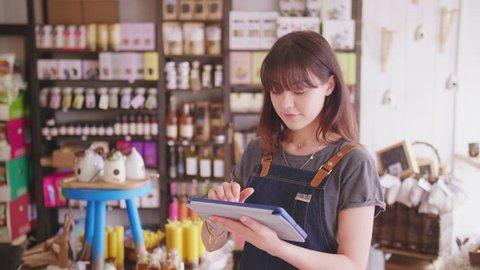 Young Deli Owner Using Digital Tablet In Delicatessen