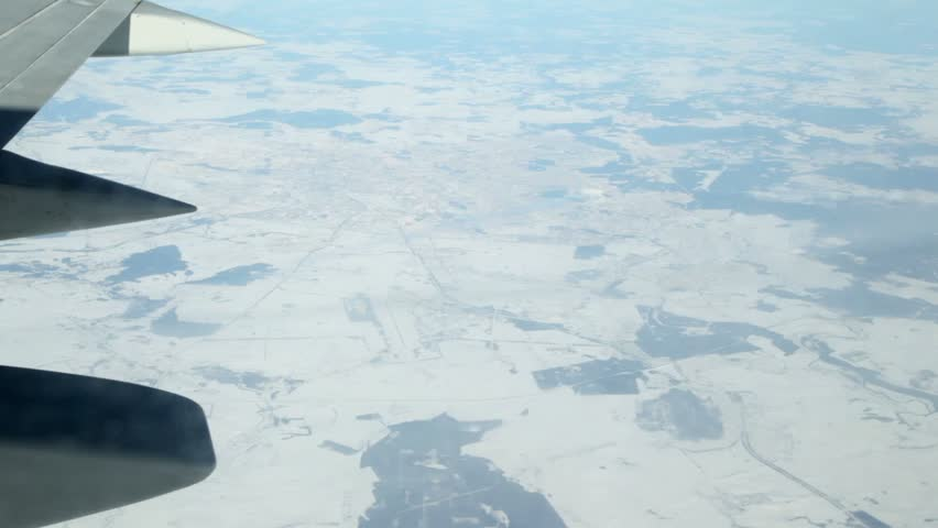 Earth with northern town, view from an aircraft window