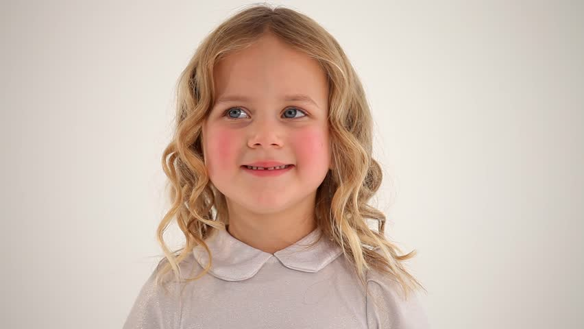 Close up shot of small cute nice little girl child toddler with rosy cheeks blond curly hair looking smiling in camera #29418721