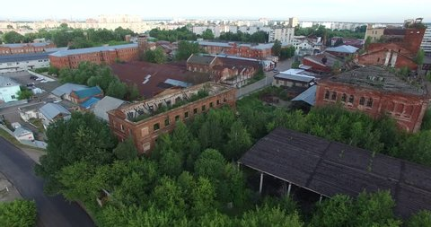 4K aerial view drone video of Orekhovo-Zuevo railway tracks, abandoned dilapidated old factory buildings, area near main railway station in small town 100 km east of Moscow, Russia on summer morning