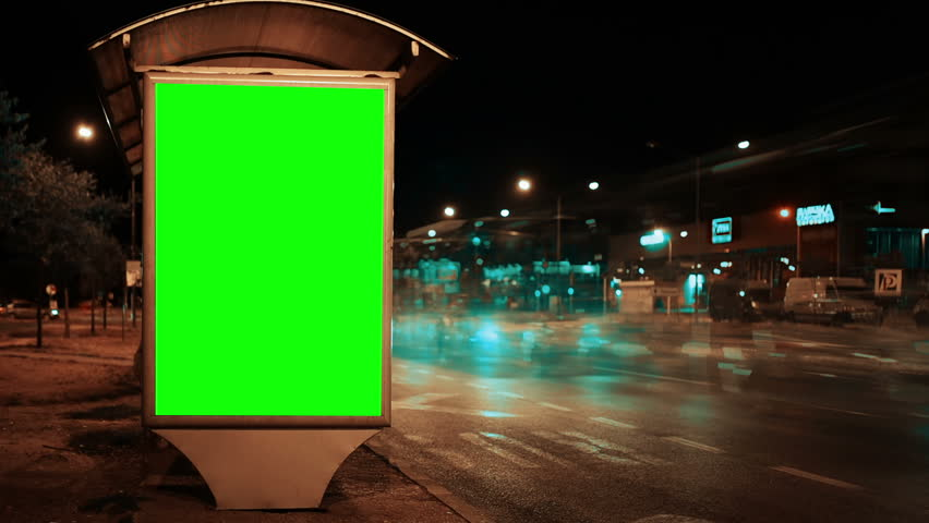 Blank green screen advertising billboard on street at night with traffic time lapse, useful for chroma keying | Shutterstock HD Video #29500051