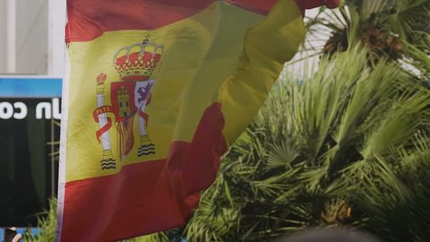Spanish flag fluttering in wind, national symbol of country, patriotic feelings