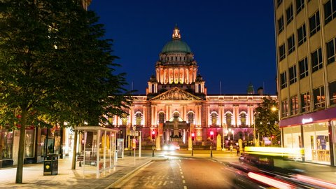 Belfast, UK. Nightlife with city hall in Belfast, UK the capital of Northern Ireland. Time-lapse of car traffic ar night with dark blue sky