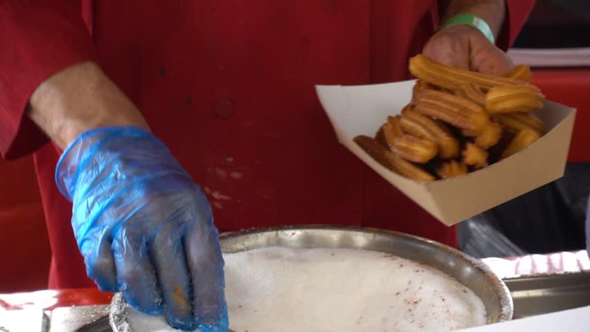 Putting sugar on the churros- close up