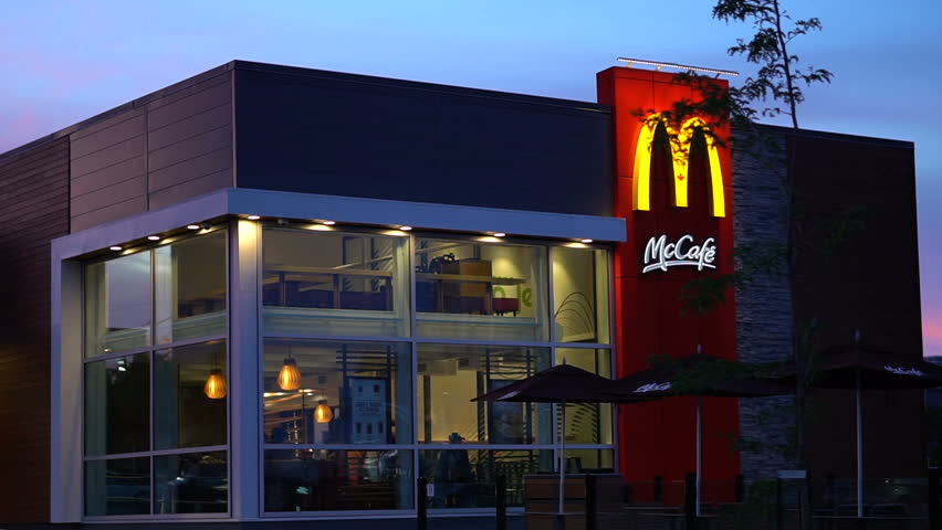 LAVAL, QUEBEC - AUGUST 2017: Smooth & stabilized slow motion shot of a McDonald's fast food restaurant building during a beautiful evening