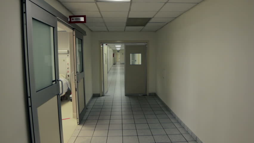 Walking in the corridor of a clean hospital - HD stock video clip