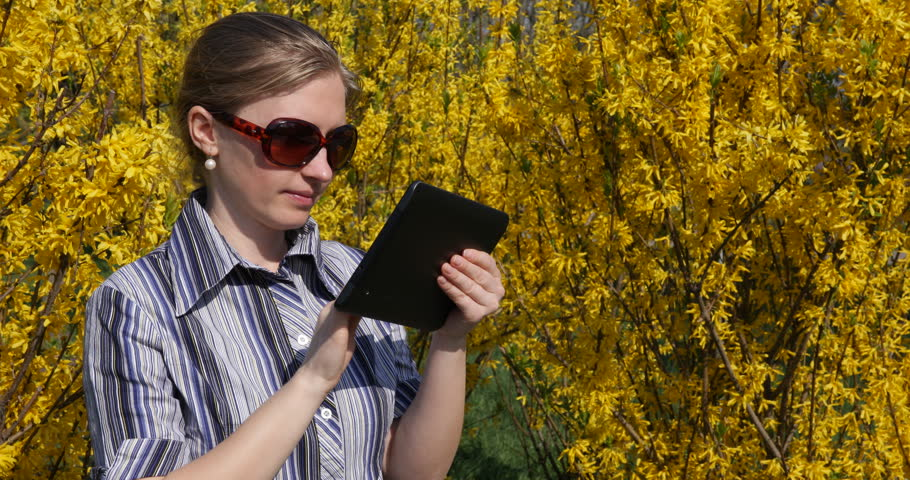 Business Woman Work On Digital Tablet In Park Near Flower, Girl Looking Camera Smiling   Shutterstock HD Video #29730001